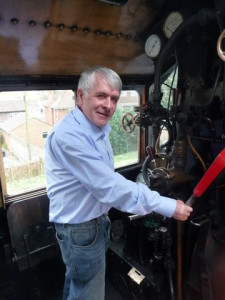 Dr Julian Kenyon drives a steam locomotive